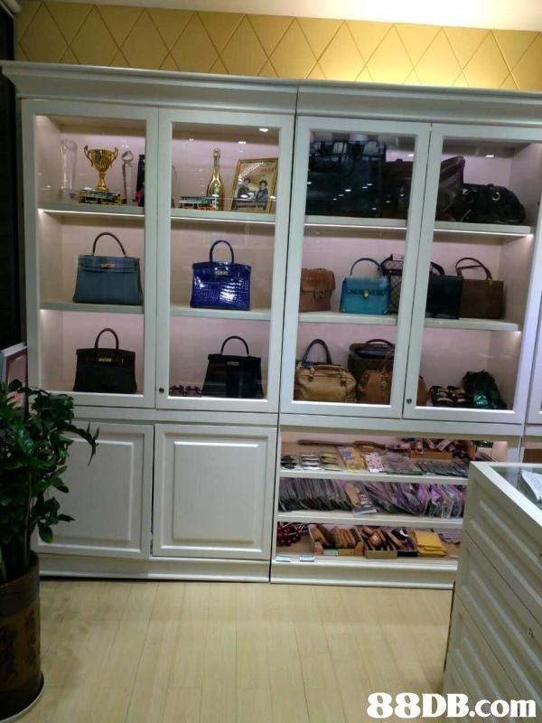 room,display case,shelving,refrigerator,furniture