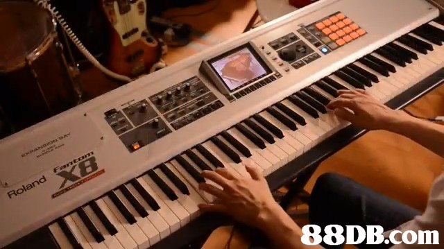 musical instrument,keyboard player,piano,electronic instrument,keyboard
