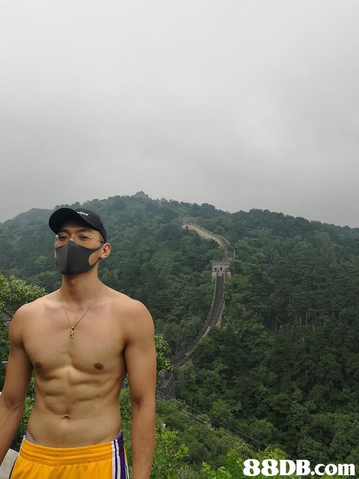 mountainous landforms,sky,barechestedness,male,mountain