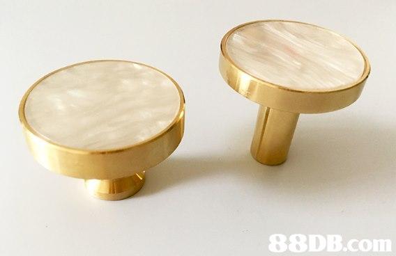 brass,body jewelry,table,metal,