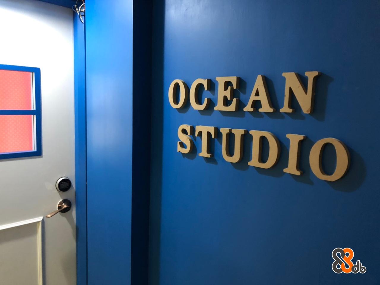OCEAN STUDIO  Blue,Font,Room,Signage,Door