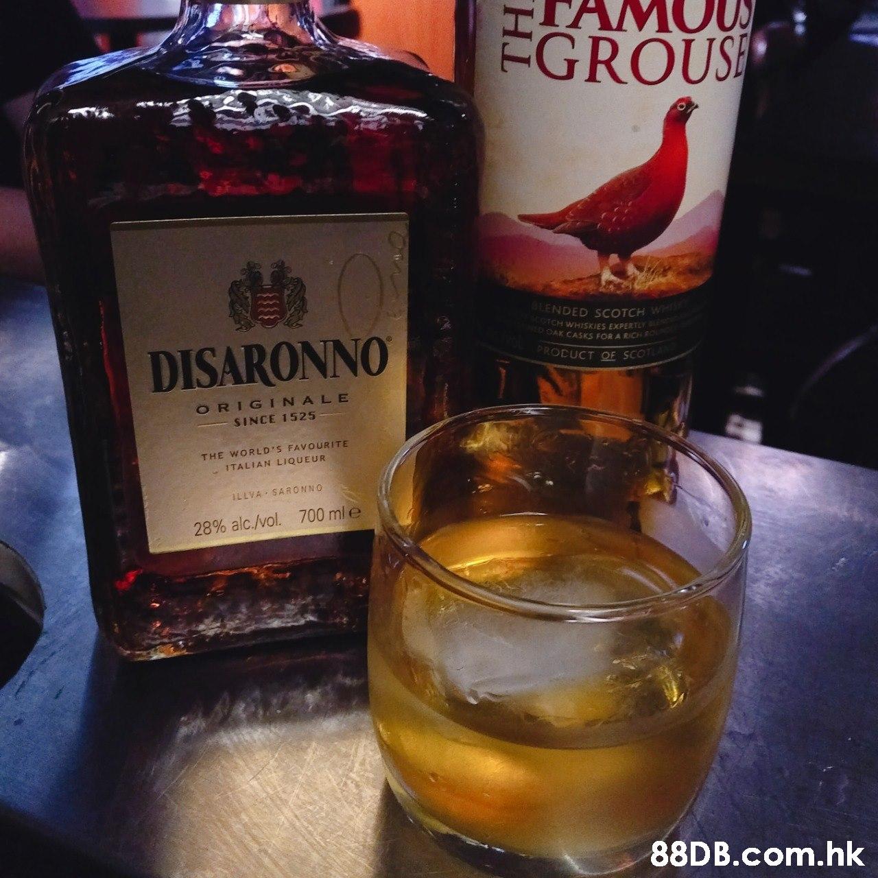 ÉGROUSE BLENDED S COTCH WHIS SCOTCH WHISKIES EXPERTLY BLENR OAK CASKS FOR A RICH R DISARONNO PROCUCT OE SCOTLA ORIGINALE SINCE 1525 THE WORLD'S FAVOURITE - ITALIAN LIQUEUR ILLVA - SARONNO 700 mle 28% alc./vol. .hk  Drink,Liqueur,Alcoholic beverage,Distilled beverage,Bottle